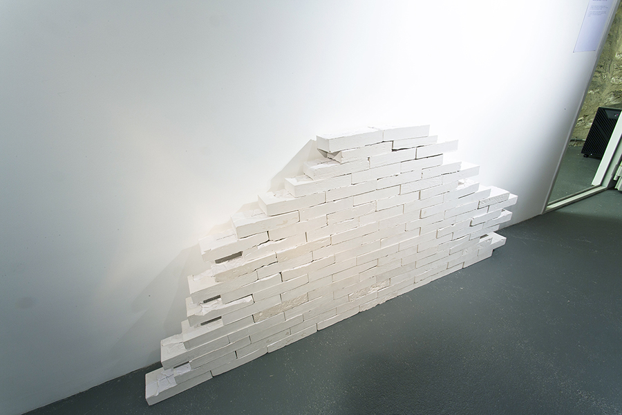 Sophie Bouvier Ausländer Construction, 2015, installation of a wall, made of plaster bricks, inkjet on paper, 100 different bricks, size of one brick: 11 x 23.5 x 5 cm