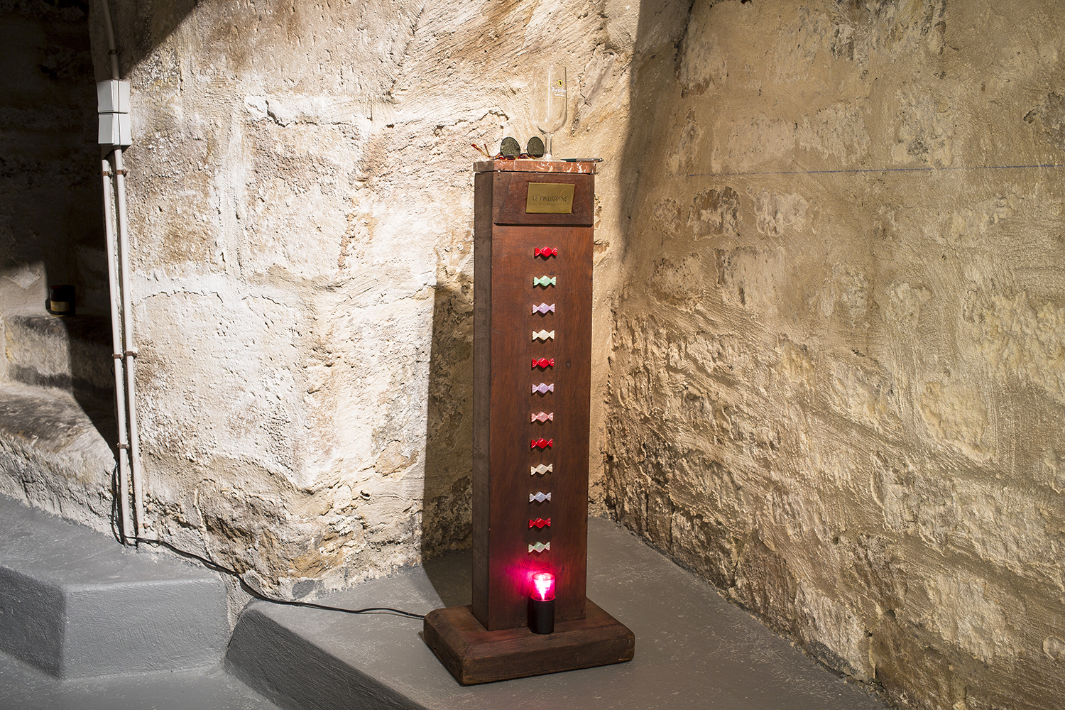 Pierre Petit Le Philosophe, 1989 Wooden base, marble, engraved copper plate, plastic candies, glasses, Jupiler glass, pencil, strobe 113 x 25 x 25 cm
